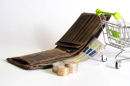 A wallet, a shopping cart and euro bills Stock Photo