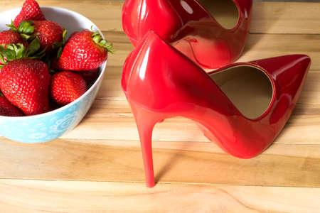 Red high heels and strawberries Banco de Imagens