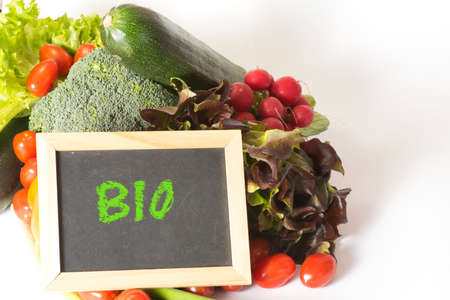 A chalk board with the word bio and different vegetables