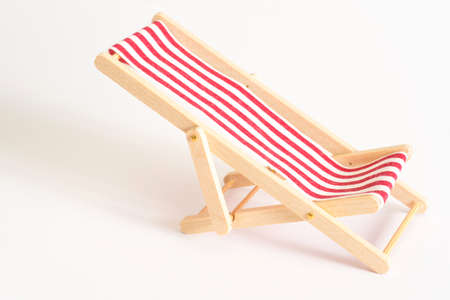 A deck chair on a white background