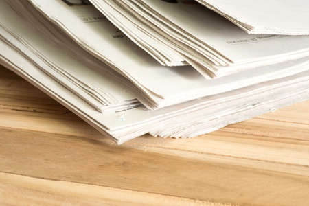 A stack of different newspapers