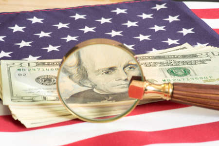 American flag, dollar bills and a magnifying glass Banco de Imagens