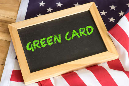 American flag and a chalk board with the text Green Card