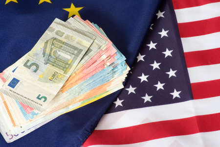 Flags of the EU and USA and many Euro banknotes Reklamní fotografie