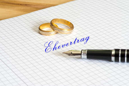 A handwritten marriage contract, a fountain pen and a booklet Stock Photo