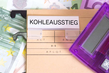 A folder with the imprint Kohlausstieg and many euro banknotes