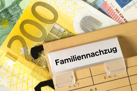 Euro banknotes and a folder with the imprint Family Reunion 写真素材 - 102105701