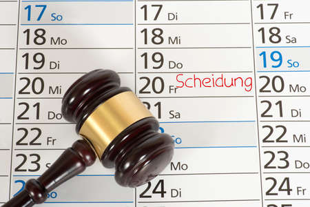A gavel and a calendar with the date for a divorce