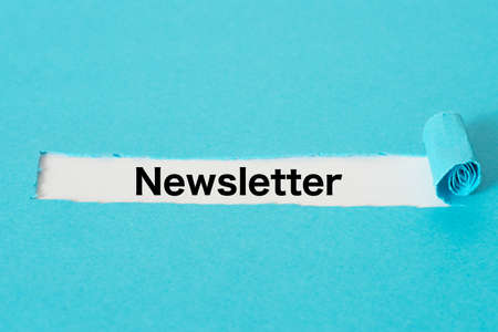Piece of blue paper and the word Newsletter Stock Photo