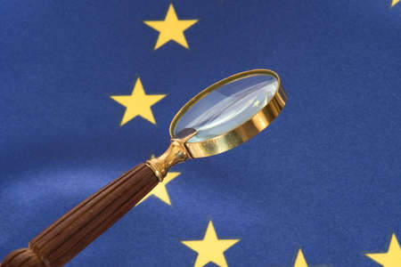 Flag of the European Union EU and a magnifying glass Stock Photo