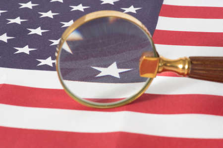 Flag of USA and a magnifying glass Stock Photo
