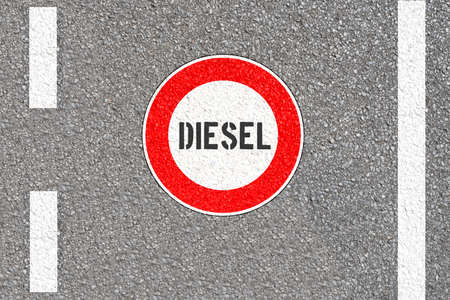 A road and sign prohibiting entry for diesel