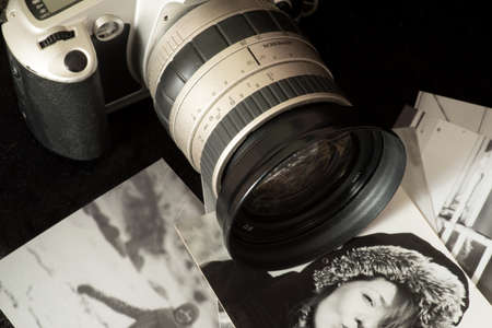 An old, analog camera and black and white photos