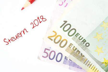 Euro bills and taxes 2018 Stock Photo