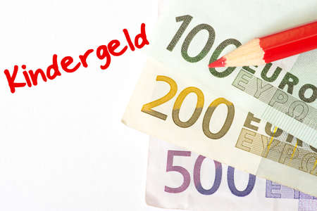 Euro banknotes, a red paint pen and child support