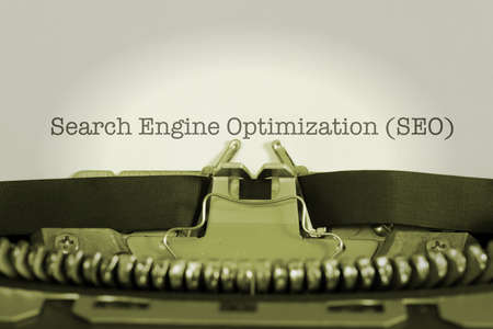 A typewriter and a piece of paper with the word SEO Search Engine Optimization