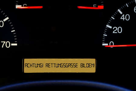 A dashboard in the car and memory of the formation of a rescue lane in a traffic jam