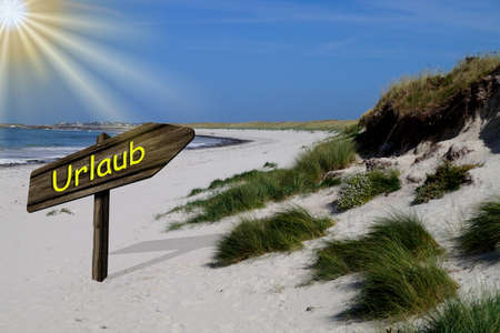 A beach and signpost towards vacation Stock Photo