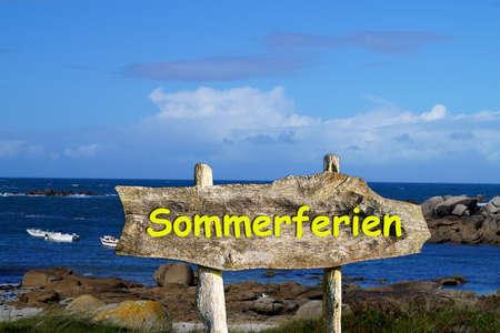 Sea and a sign indicating summer vacations