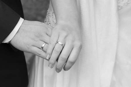 A bride, groom and wedding ring at a wedding Stock Photo