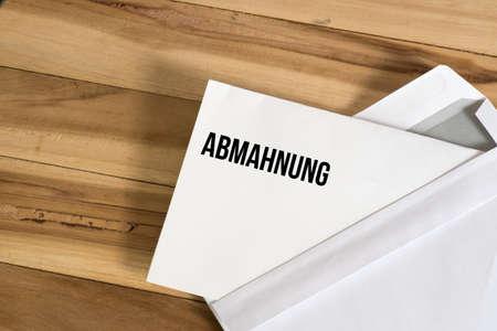 An envelope and a written warning Stock fotó - 105664538