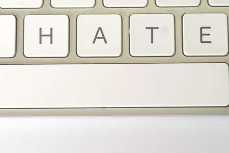 A computer and the buttons for hate
