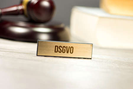 A gavel, law books and privacy basic regulation DSGVO Stock fotó