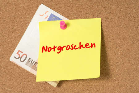 Euro bank note and a message nest egg on a whiteboard Standard-Bild