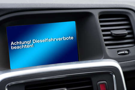 A car and an on-board computer with reference to diesel driving bans Stock Photo