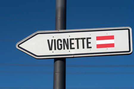 A signpost shows vignette duty in Austria