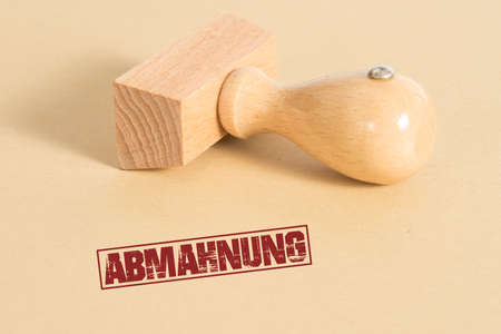 A stamp with the words Abmahnung