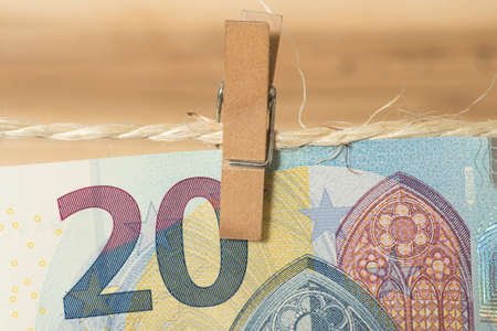 A 20 Euro bill on a clothesline with clothespin Imagens