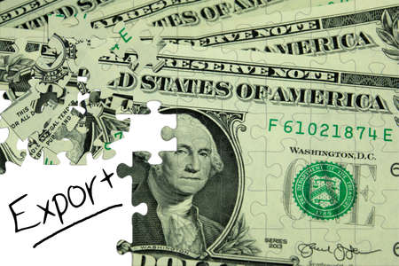 A puzzle, dollar bill and the word export