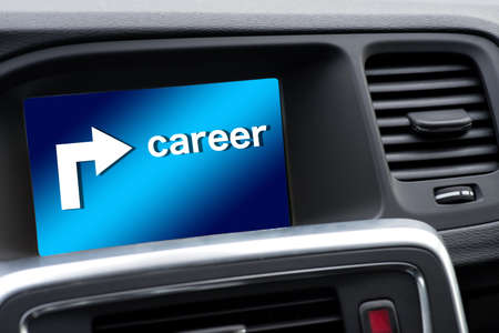 A navigation device in the car shows the way towards career Stock Photo