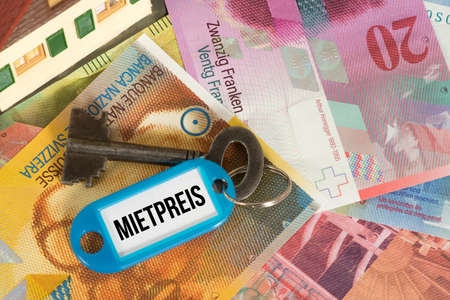 Swiss franc, house key and rental price in Switzerland