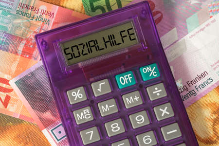 Swiss franc, calculator and social assistance in Switzerland Stock Photo