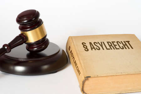 A gavel and a law book with asylum rights Stockfoto - 104195614