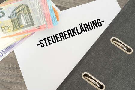 Euro bills and a tax return