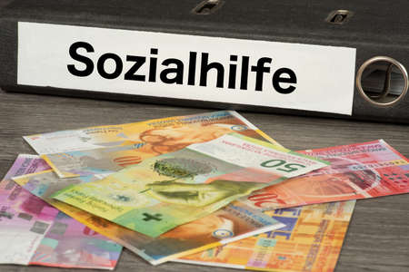 Banknotes Swiss francs and social assistance in Switzerland
