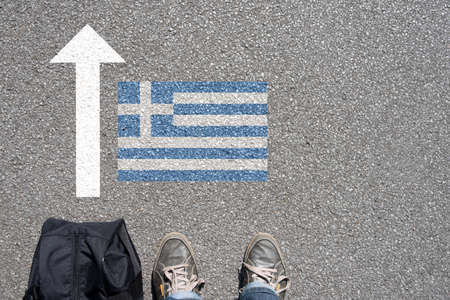 A man with the suitcase travels to Greece