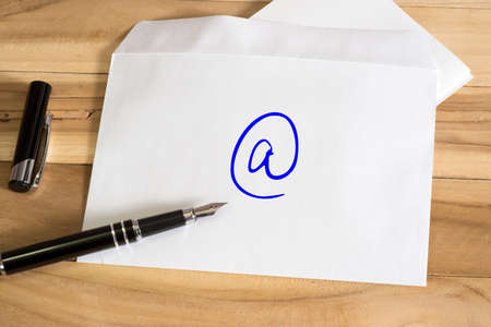 An envelope with the eMal symbol and an elegant fountain pen Stock Photo