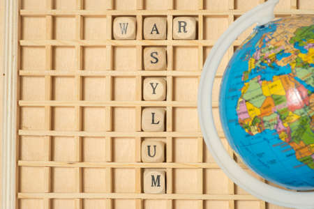 A globe, wooden letters and words War and asylum