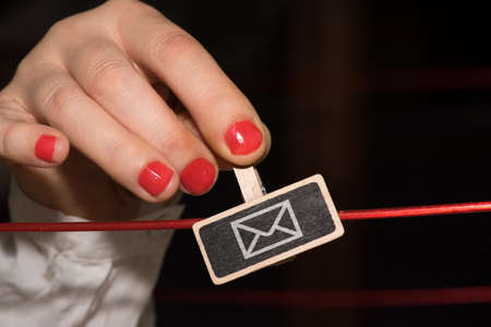 A woman and a letter as an e-mail symbol
