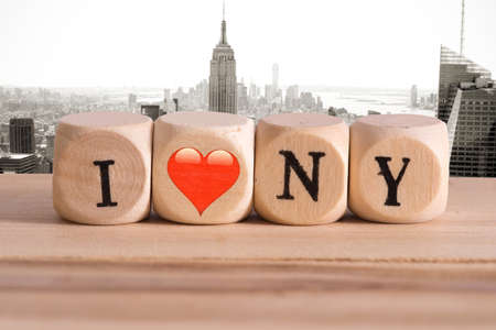 Panorama of New York and slogan I love New York made of wooden letters