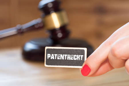 A gavel, a woman and patent law