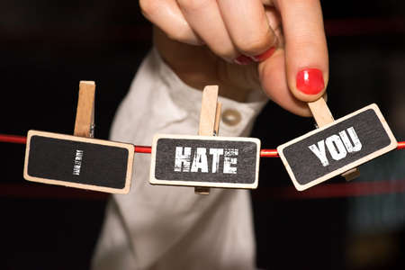 A woman and slogan I hate you Stock Photo