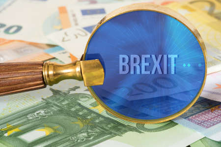 Euro bills, a magnifying glass and the Brexit