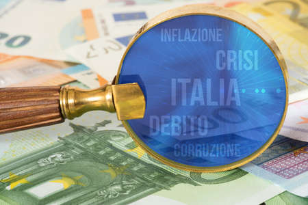Euro bills, a magnifying glass and words Italy, debt, crisis, inflation and corruption