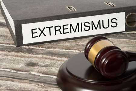 A gavel and a folder with the imprint extremism