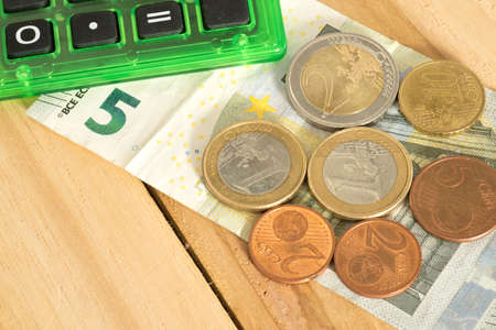 Calculator and Euro banknotes and coins as a minimum wage in Germany from 2019 Banco de Imagens